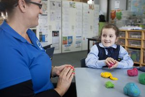 student with carer for school care