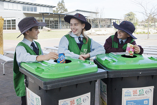 students at work as eco rangers for the school